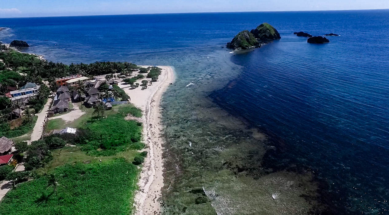 blue lagoon beach and twin islands in pagudpud ilocos norte philippines