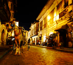 calle crisologo by night with kalesa horse carriage in vigan city ilocos sur philippines