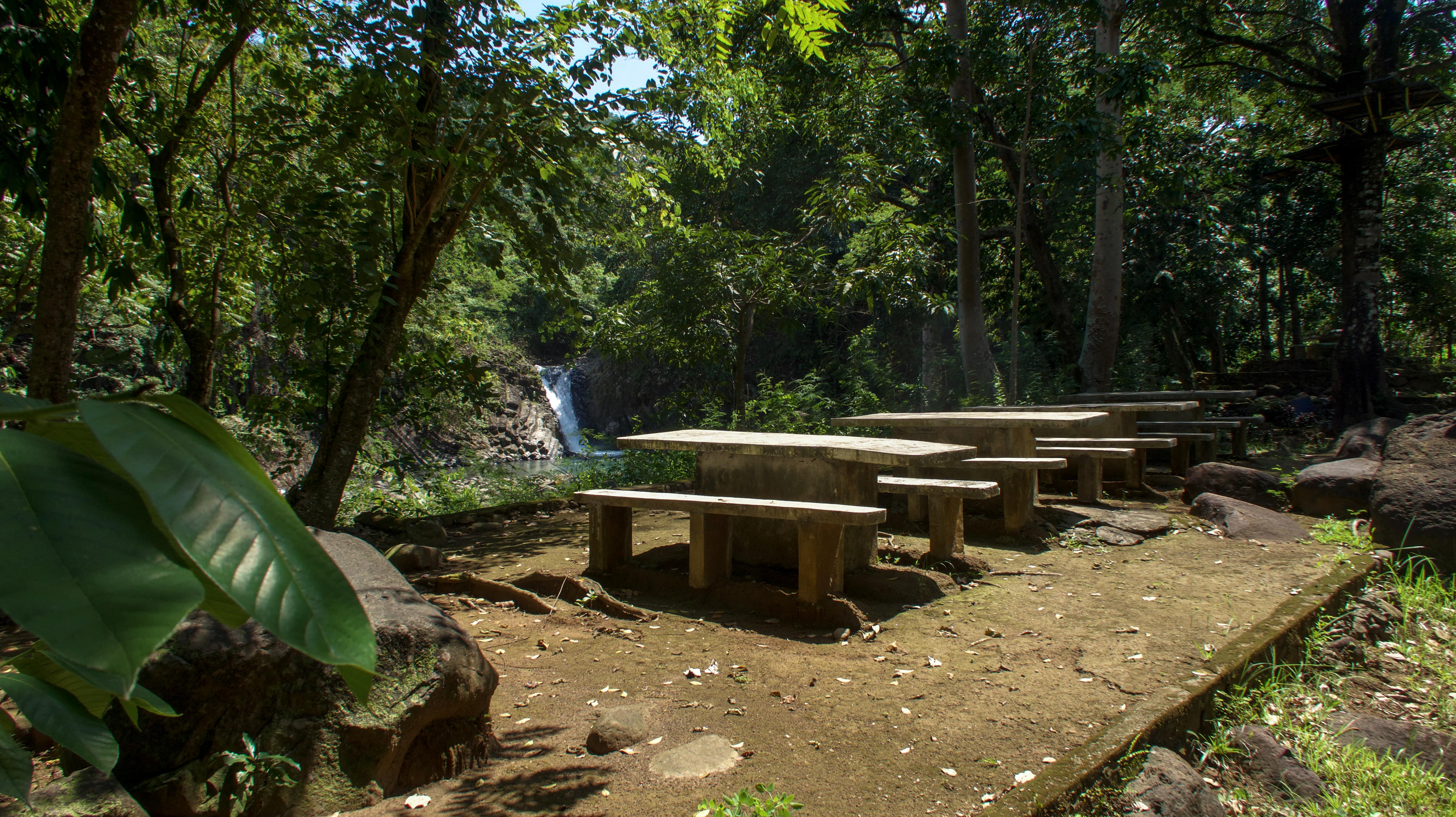 picnic tables at dunsulan falls in bataan philippines
