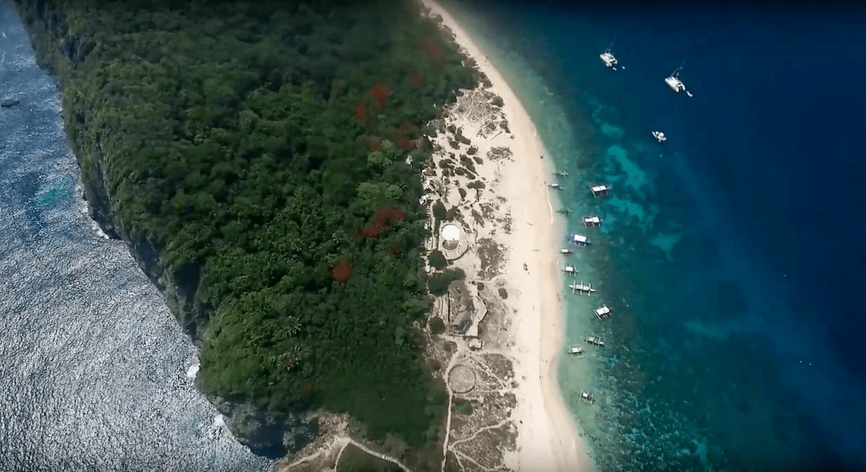 fortune island in nasugbu batangas as seen high from the sky shot by drone in philippines