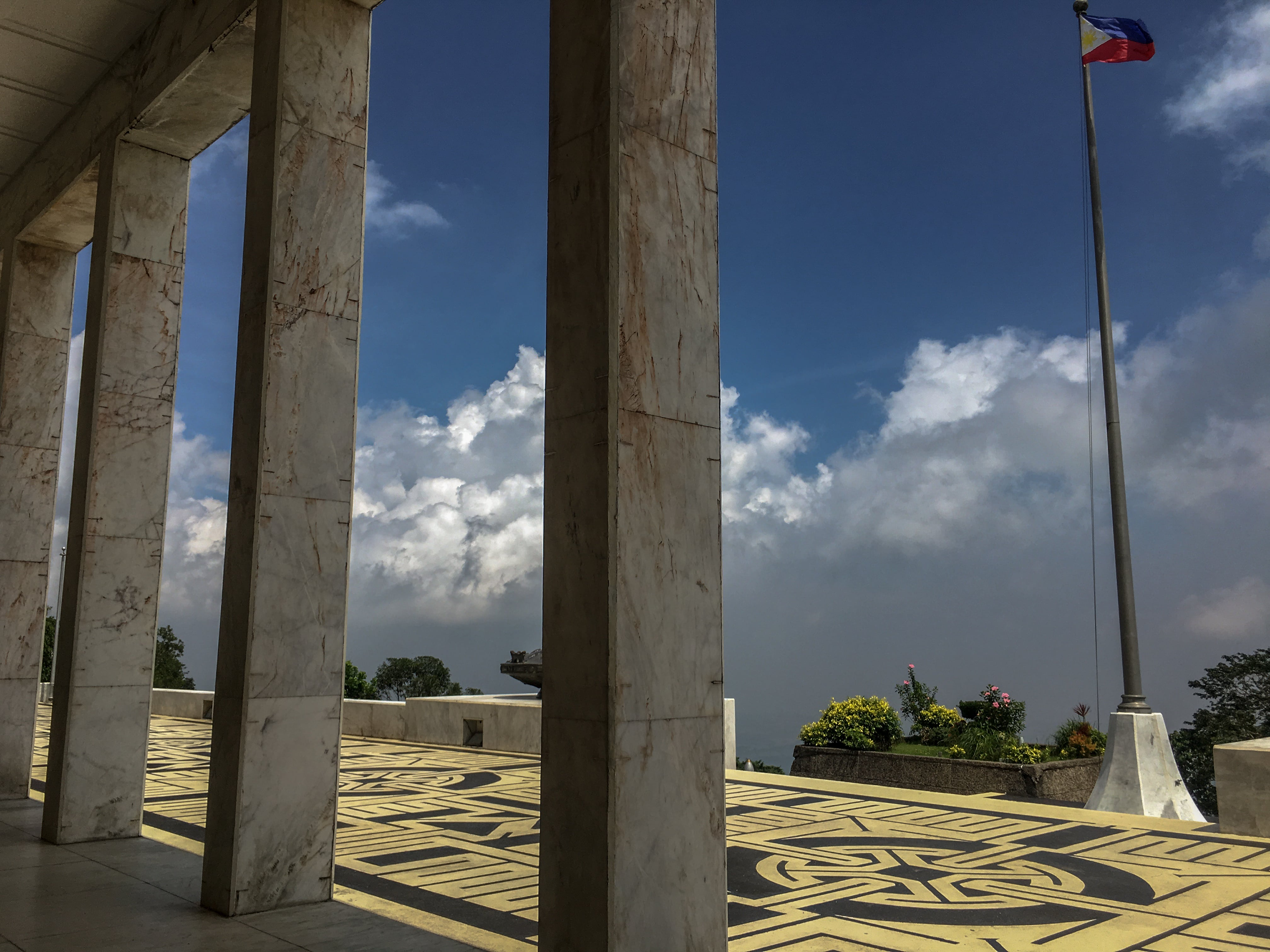 philippine flag at collonade at shrine of valor at mount samat in bataan