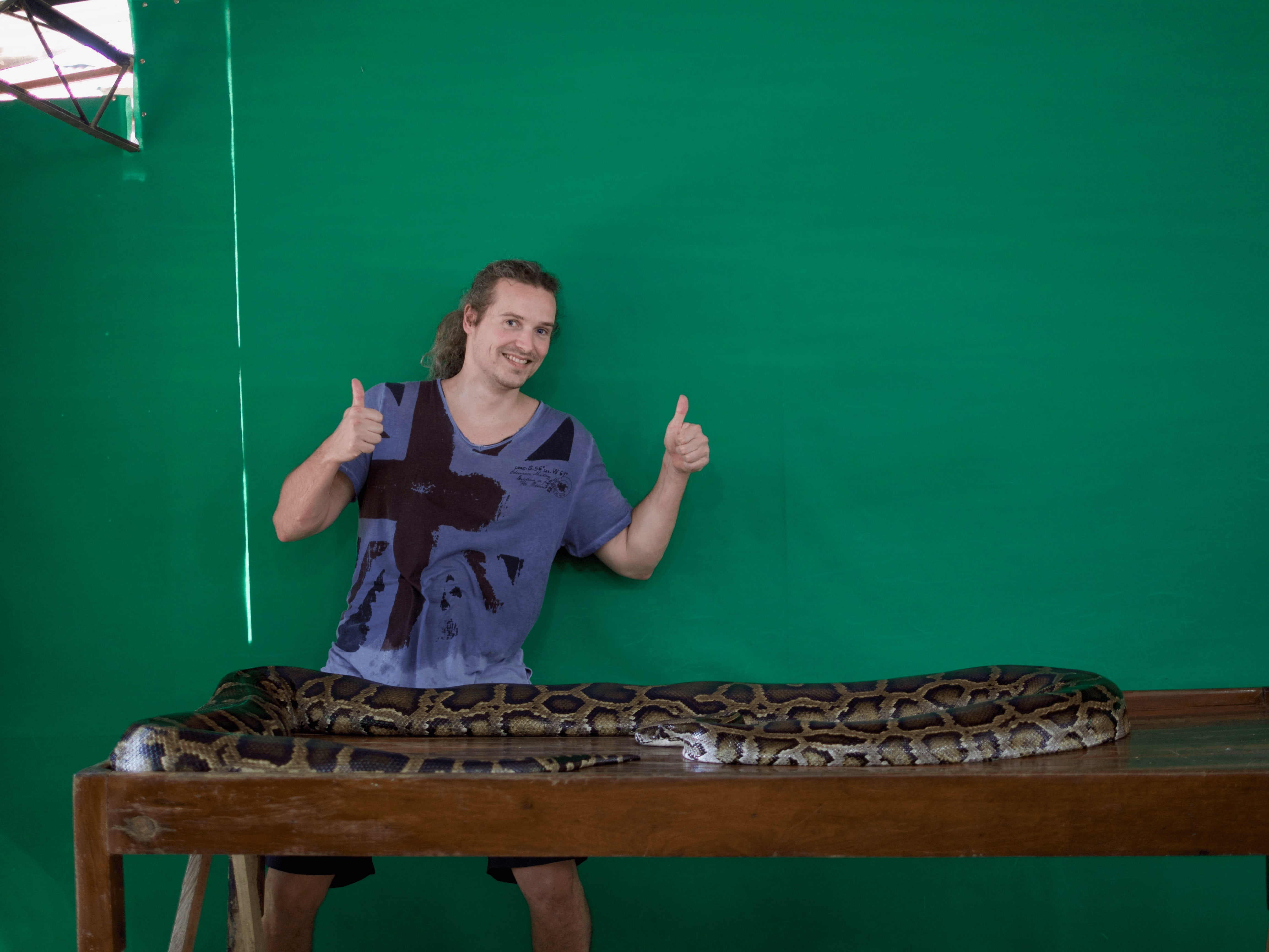 lennythroughparadise posing with boa constrictor at Palawan Wildlife Rescue and Conservation Centre