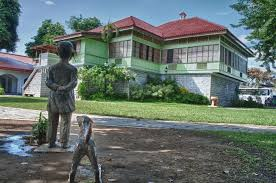 jose rizal shrine with statue of jose rizal and dog