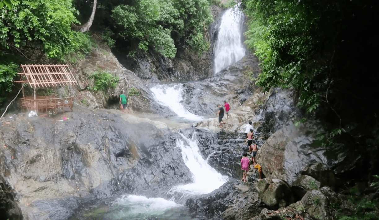 local filipino kids going closer to the Hicming waterfall in catanduanes province philippines