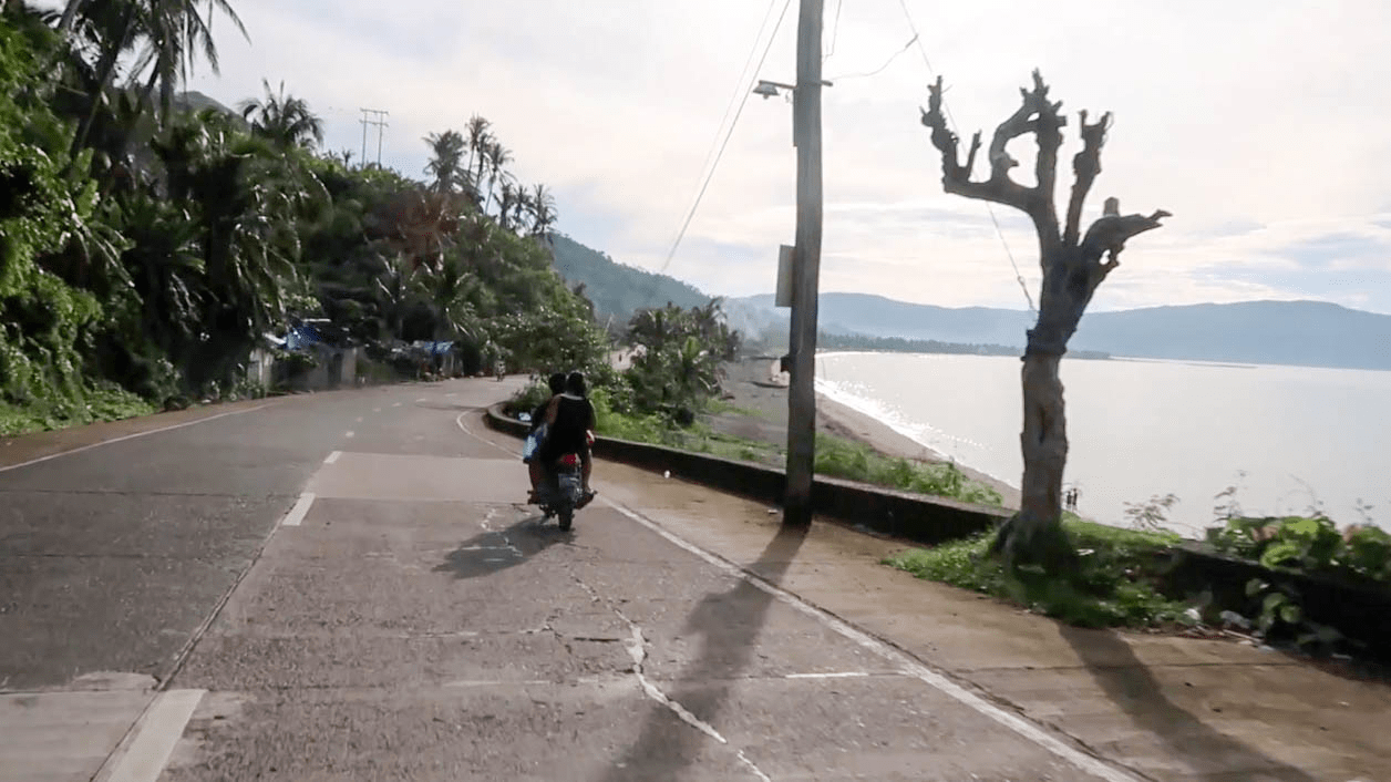 motorcycle in the philippines riding along the coastline in catanduanes island