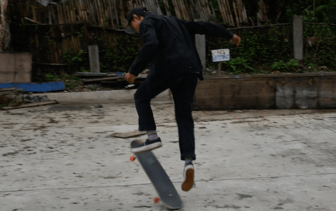 Filipino skater boy doing a trick in burnham park baguio city philippines