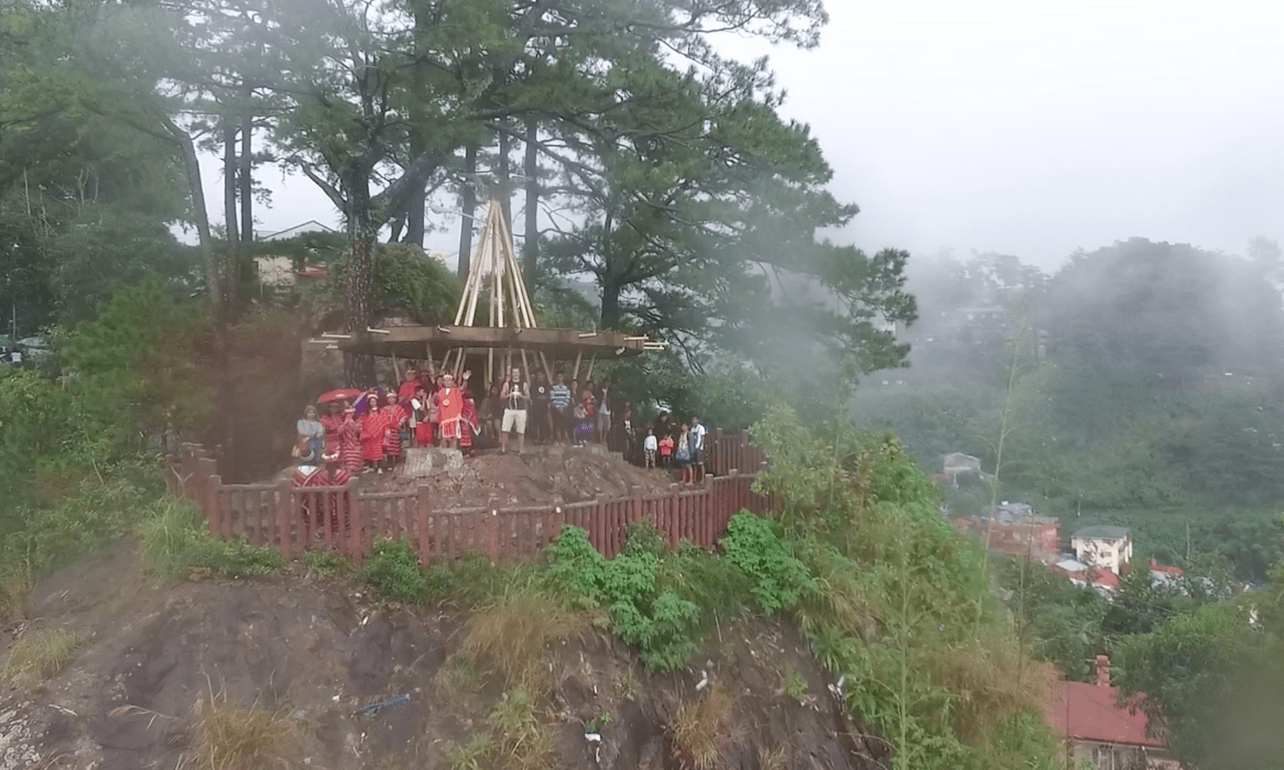 filipinos waving at Mines View Park observation deck looking over amburayan valley in baguio city philippines