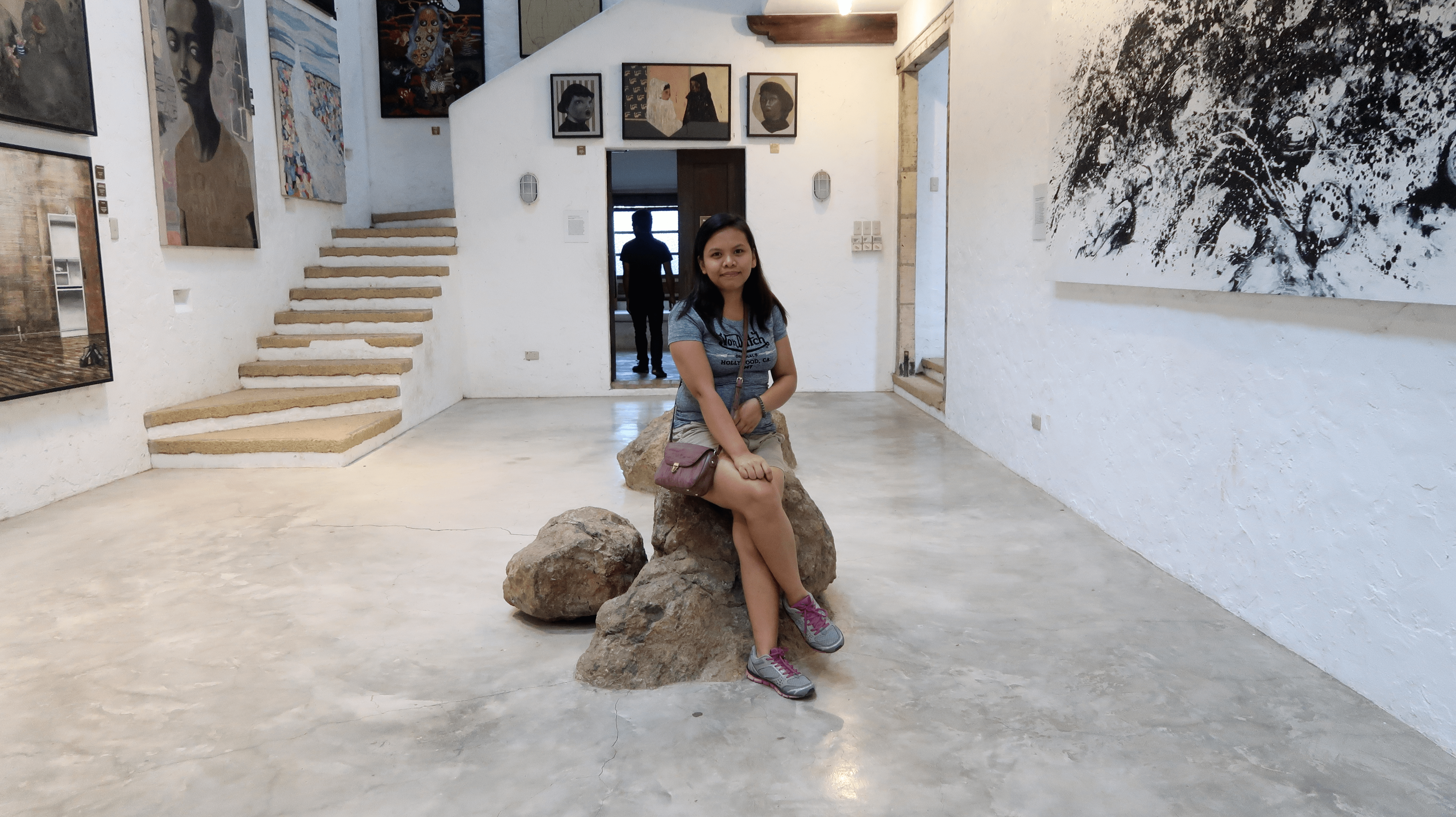 girlfriend sitting in a gallery of pinto art museum
