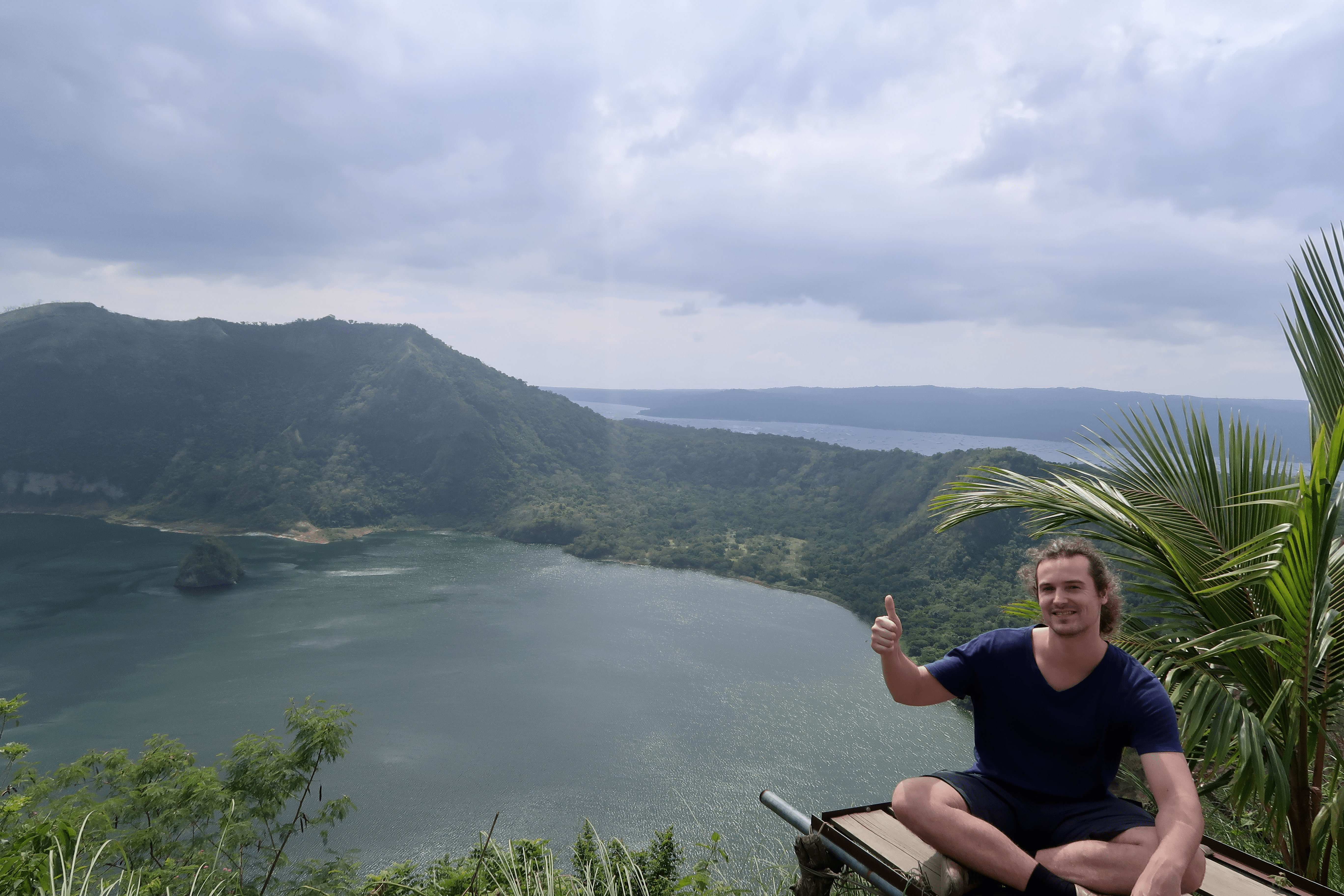 Thumbs up for the taal crater at volcano island, taal volcano