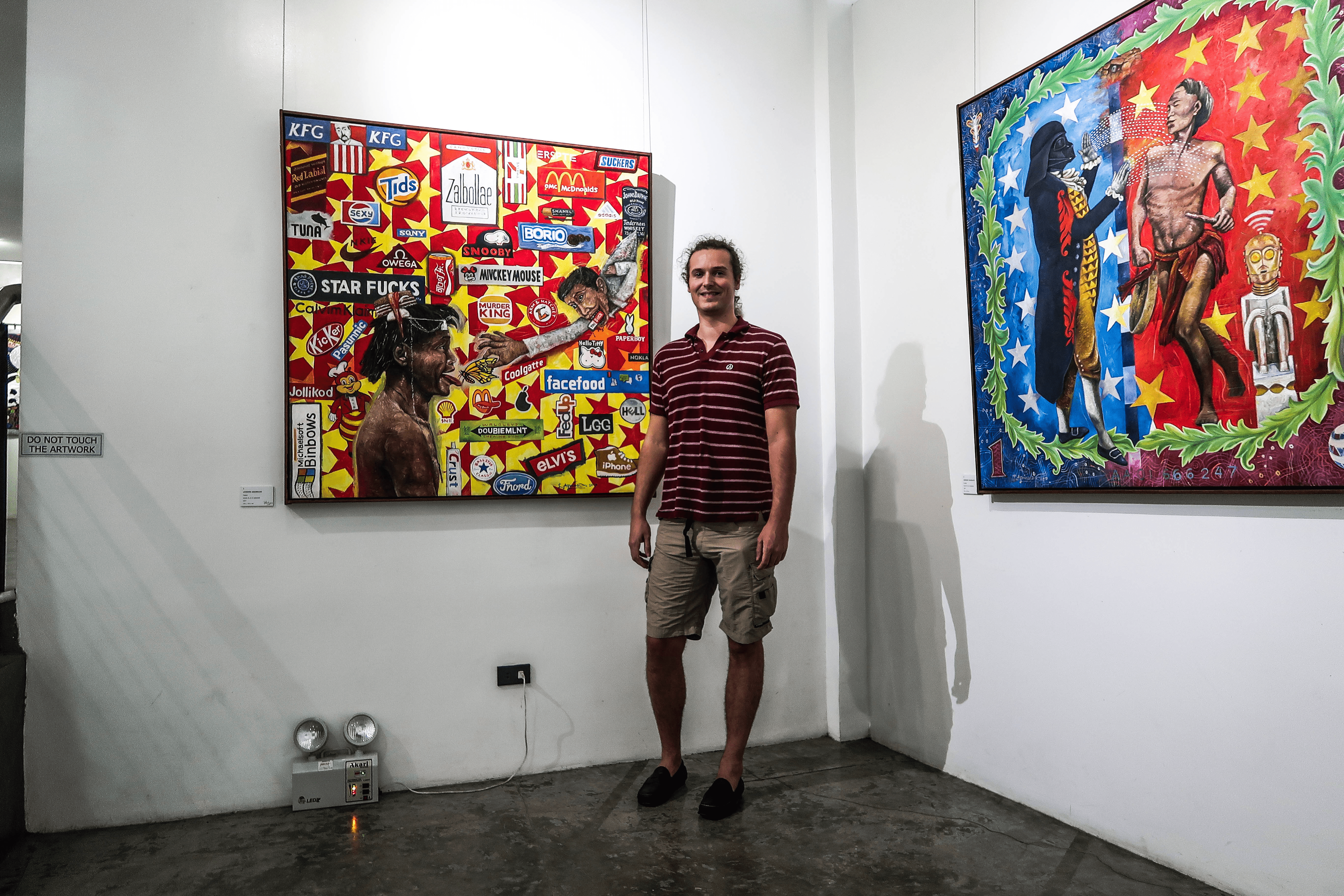 lennythroughparadise posing in the bencab museum baguio city philippines in front of an artwork