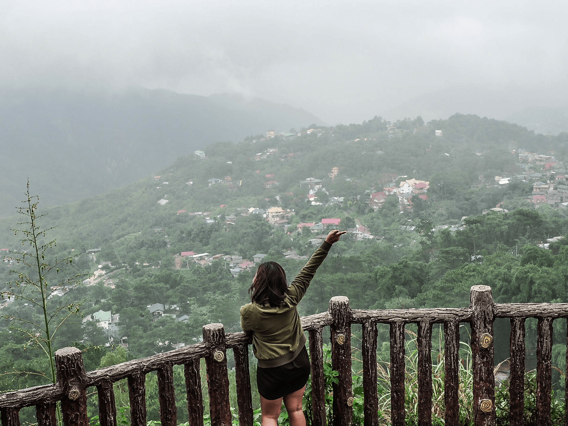 Melody somido filipina waving at valley Mines View Park baguio city philippines