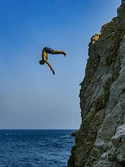 man cliff diving