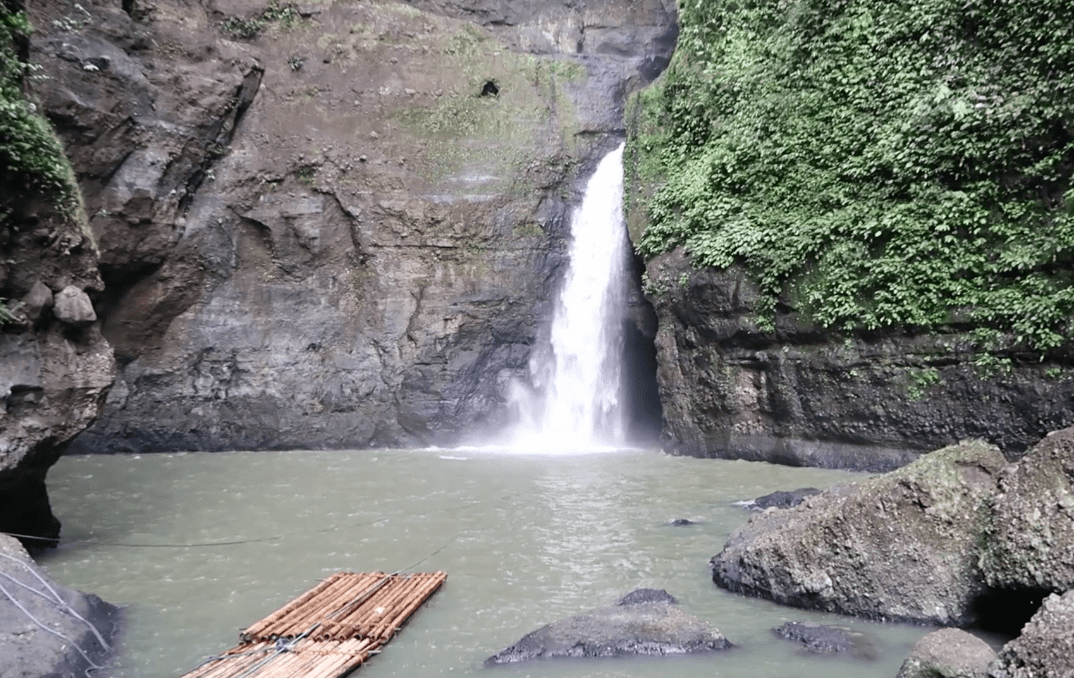 the pagsanjan waterfall in laguna philippines with wooden rafts available to take you into the pagsanjan falls