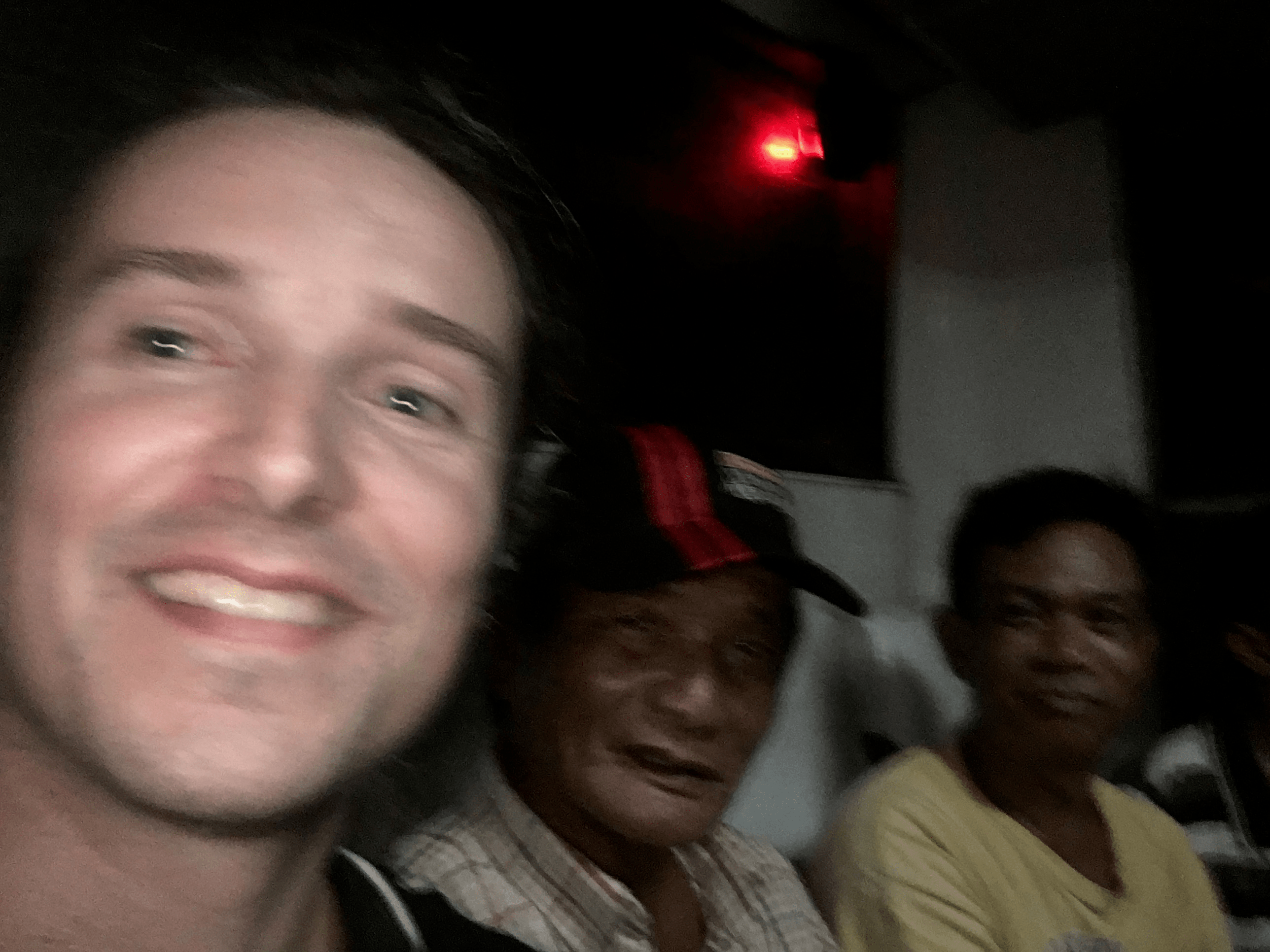 lenny through paradise taking a selfie with filipino men in the bus in the philippines pangasinan