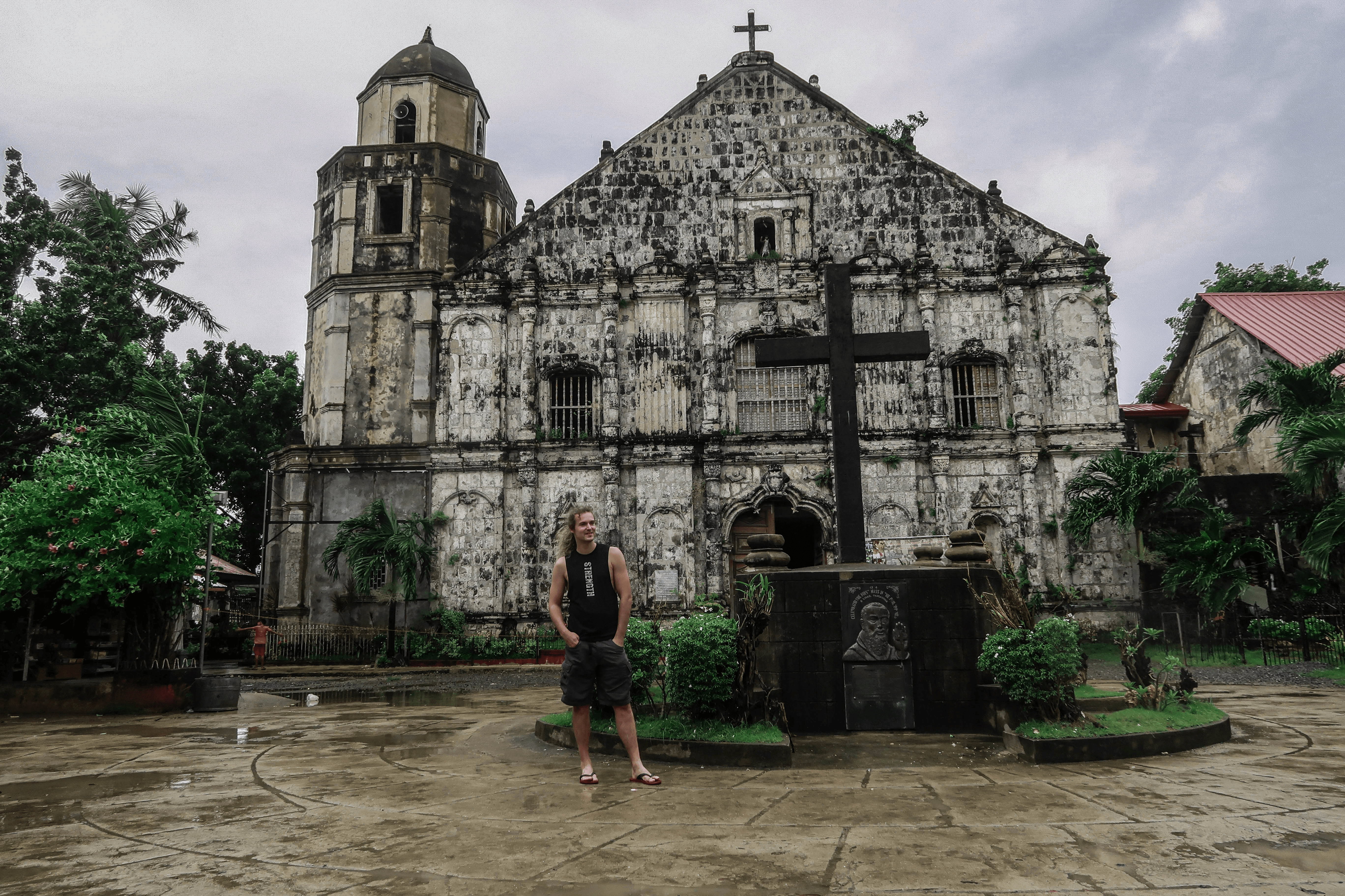lenny through paradise in front of the old church of bolinao in pangasinan philippines