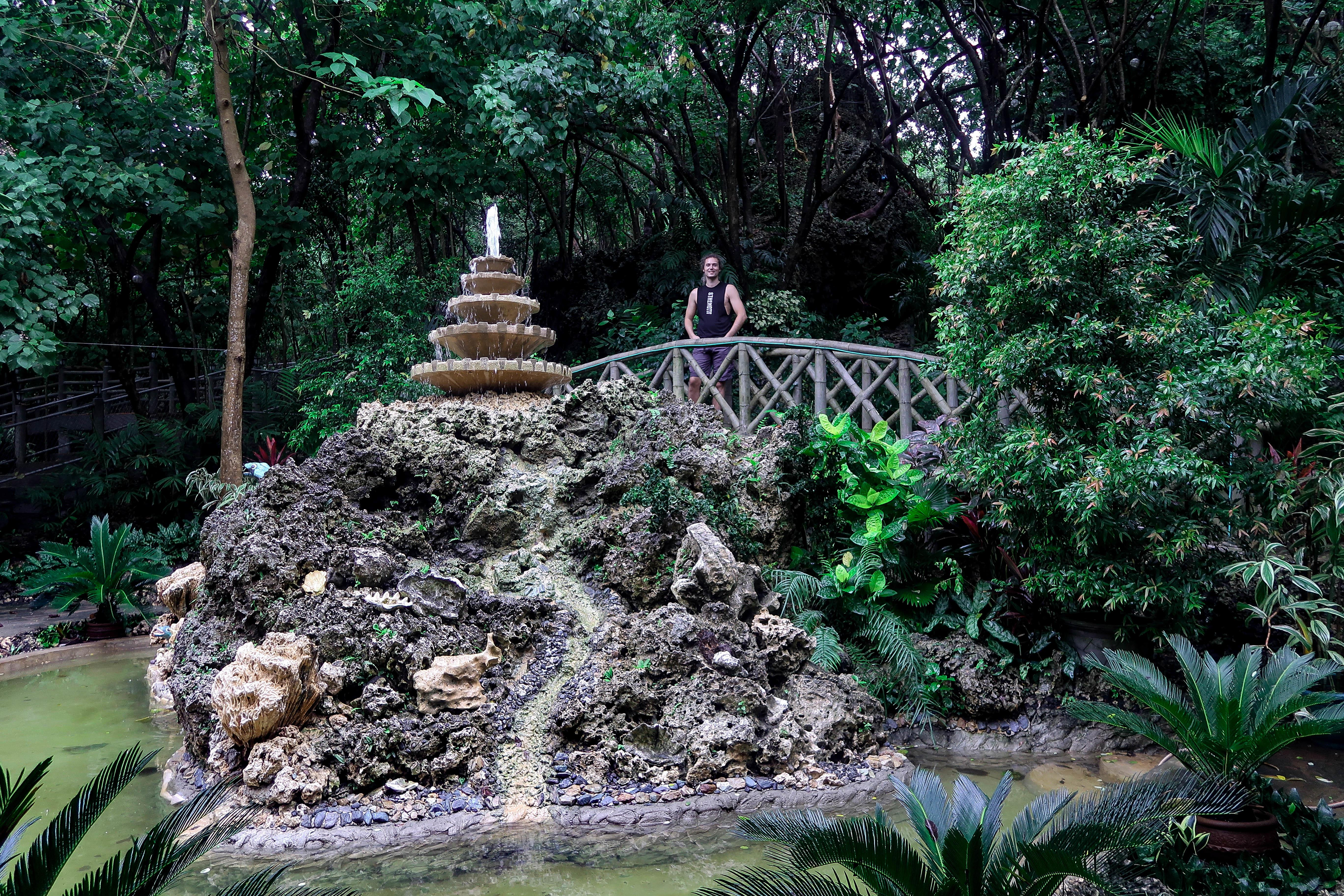 lennythroughparadise on a little bridge in the enchanted cave park in bolinao pangasinan philippines