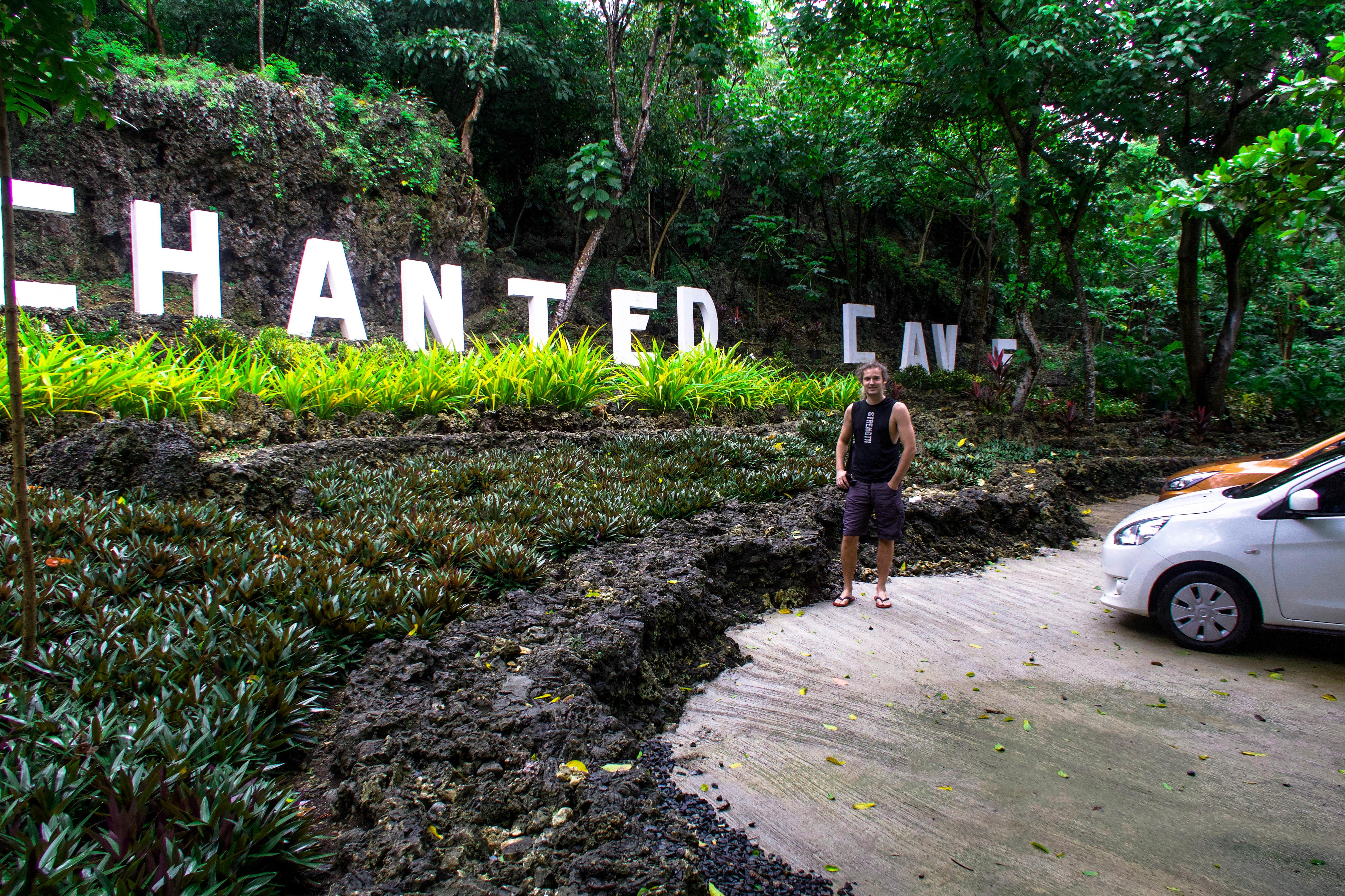 lenny through paradise with big letters of the white sign of enchanted cave bolinao pangasinan philippines
