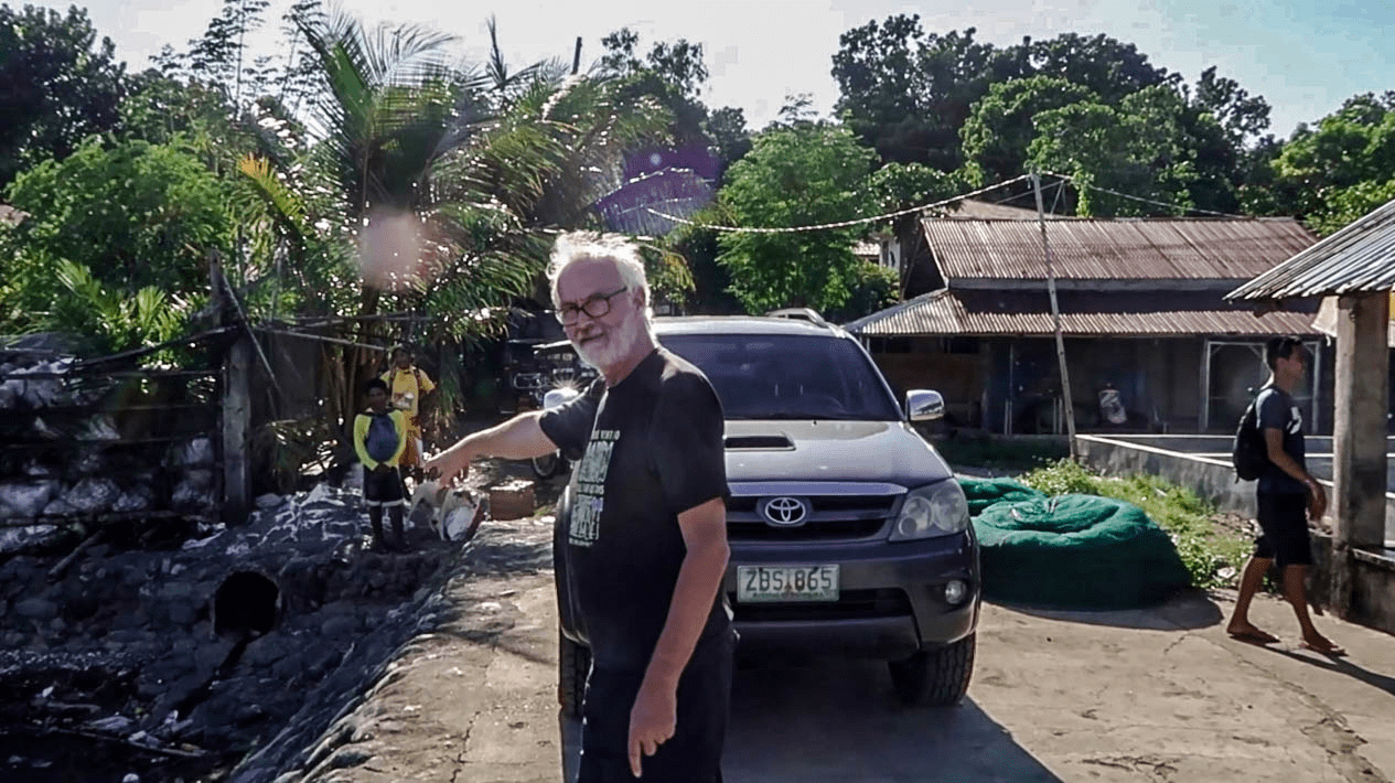 western man pointing finger in pangasinan philippines