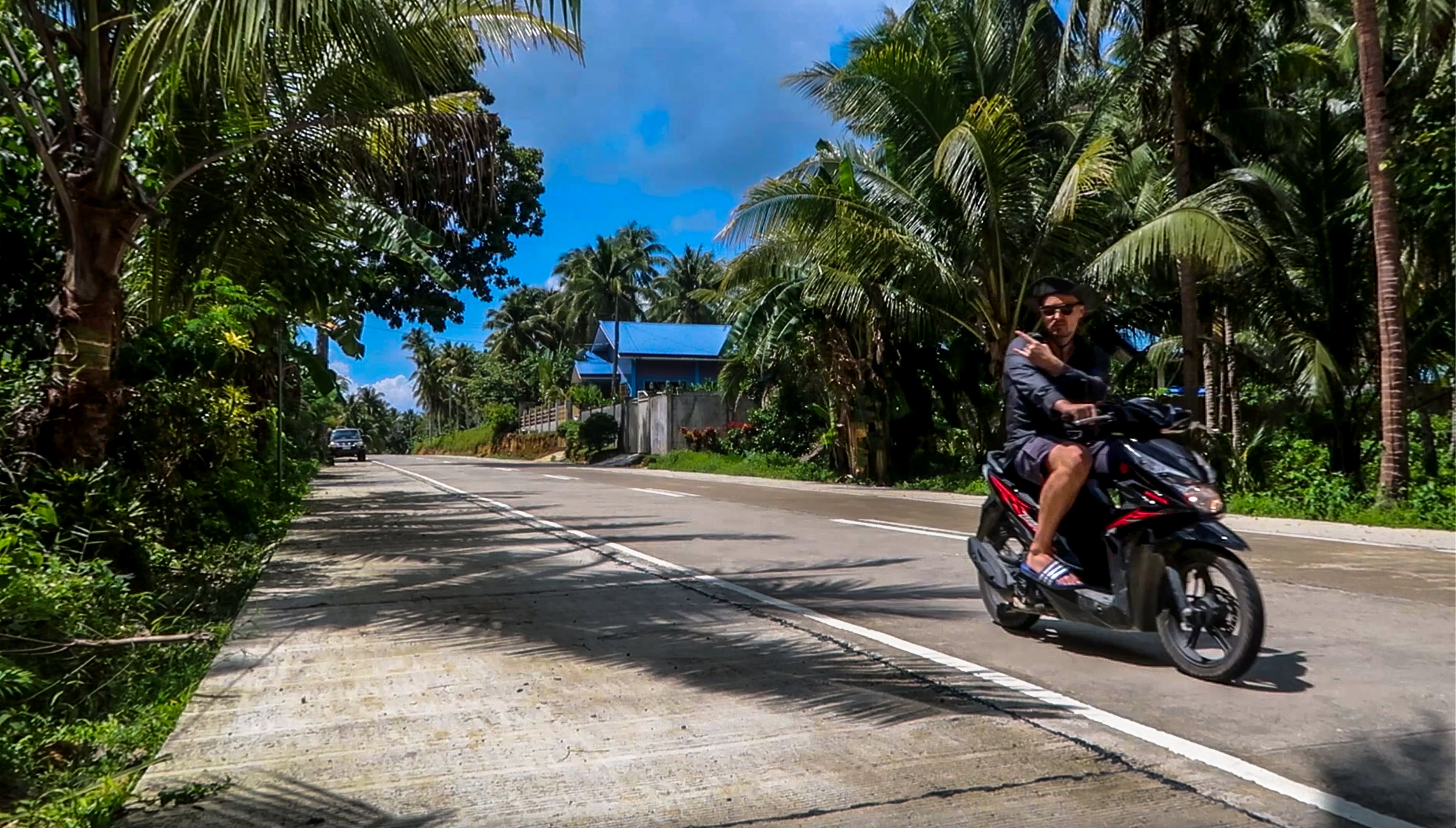 lennythroughparadise on scooter riding on siargao island in the philippines