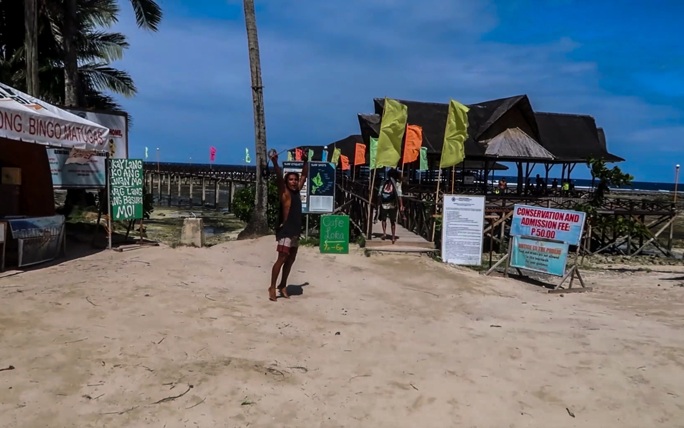 filipino surfer cheering at cloud 9 surfing spot in siargao philippines