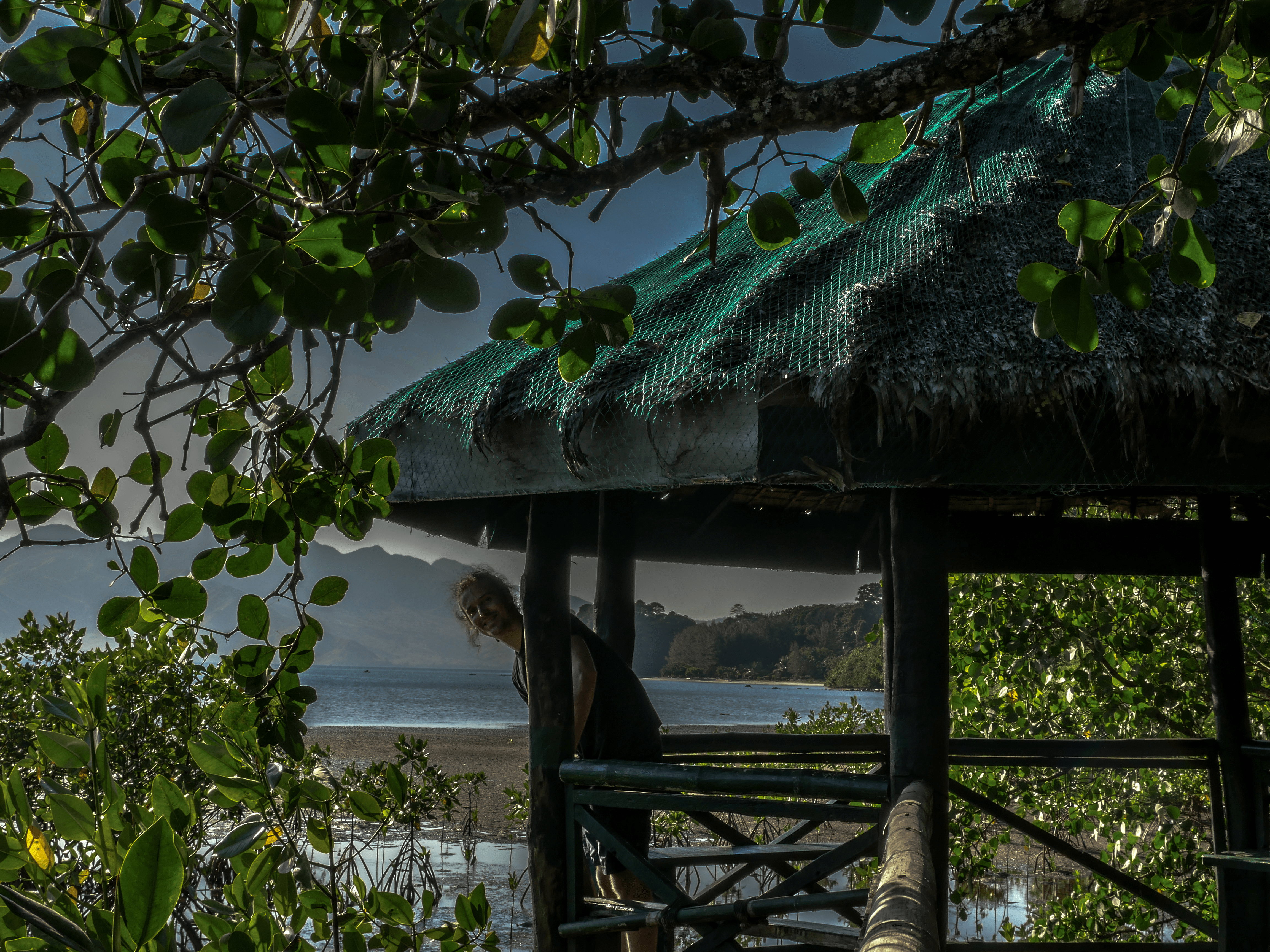 lenny through paradise smiling in little hut in triboa bay mangrove park in subic zambales philippines